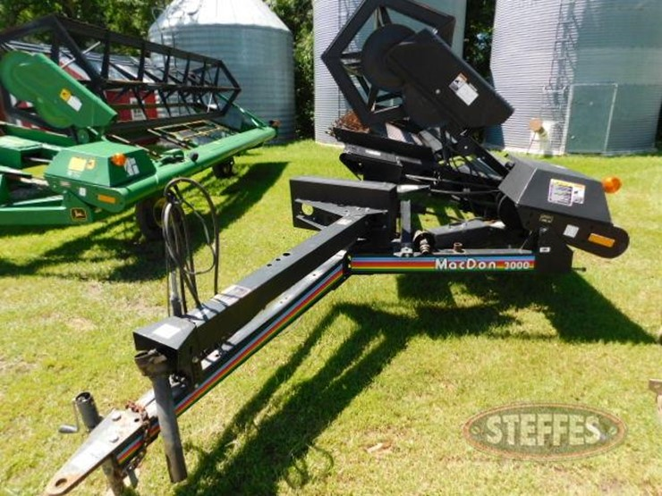 1997 MacDon Swather - Lot #63, Farm Equipment Auction, 6/22